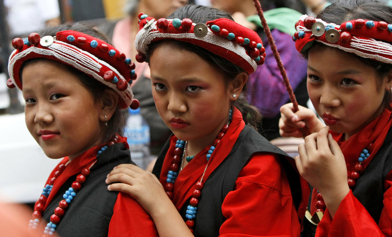 Exile Tibetan students, in traditional costume, wait to perform during celebrations marking the birthday of spiritual leader the Dalai Lama at a monastery in Katmandu, Nepal, Friday, July 6, 2012. The Tibetans held celebrations to mark the 77th birthday of the Dalai Lama, who lives in the northern Indian town of Dharmsala after his exile from Tibet during a failed revolt against Chinese rule. (AP Photo/Binod Joshi)
