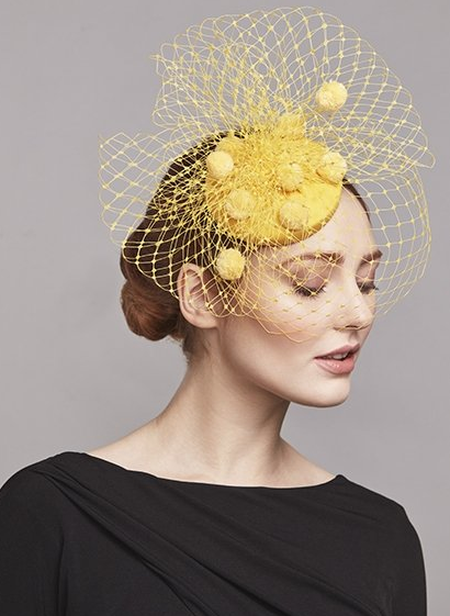 Yellow silk taffeta pillbox with pom pom veil, price on request, Rachel Trevor Morgan.