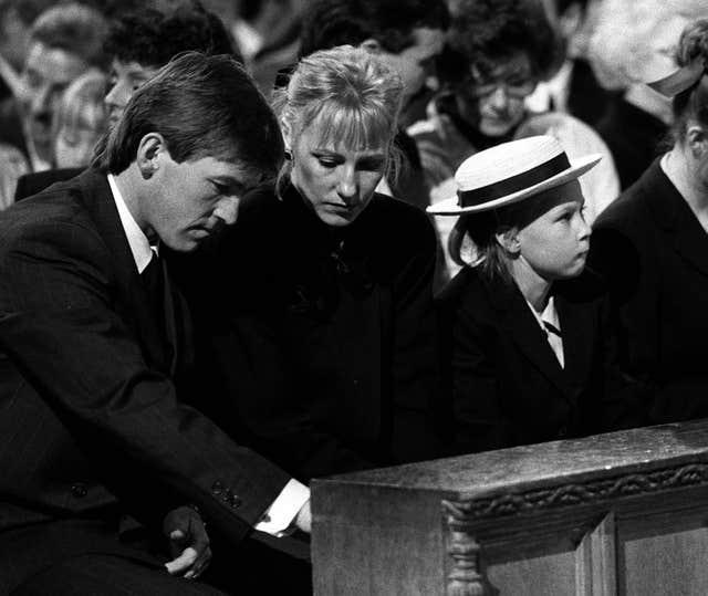 Kenny Dalglish (left) in a memorial for the Hillsborough disaster victims, 1989