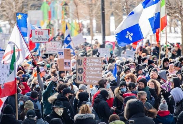 People take part in a demonstration to oppose government restrictions to curb the spread of COVID-19 in Montreal, Saturday. (Graham Hughes/The Canadian Press - image credit)