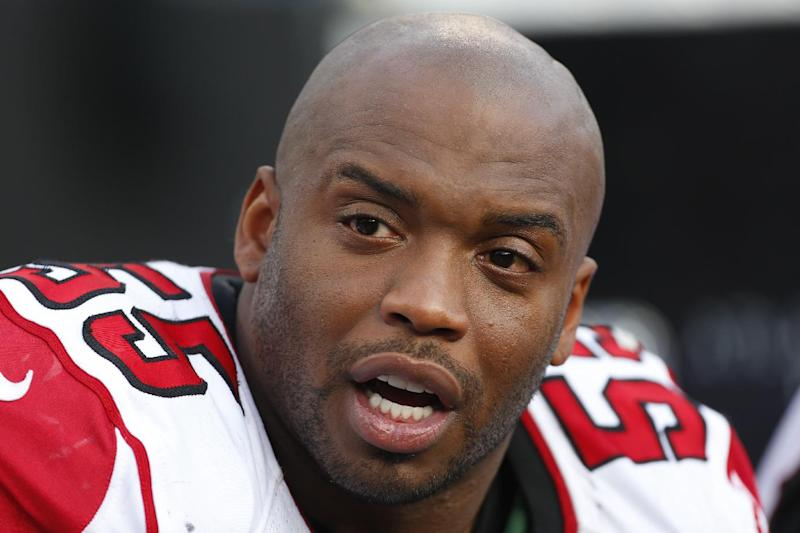 FILE - In this Dec. 9, 2012 file photo, Atlanta Falcons defensive end John Abraham is shown on the sidelines during the second half of the NFL football game against the Carolina Panthers  in Charlotte, N.C. The Falcons have released running back Michael Turner, Abraham and cornerback Dunta Robinson The moves were announced Friday, March 1, 2013, by a team that came up just short of the Super Bowl. (AP Photo/Bob Leverone, File)