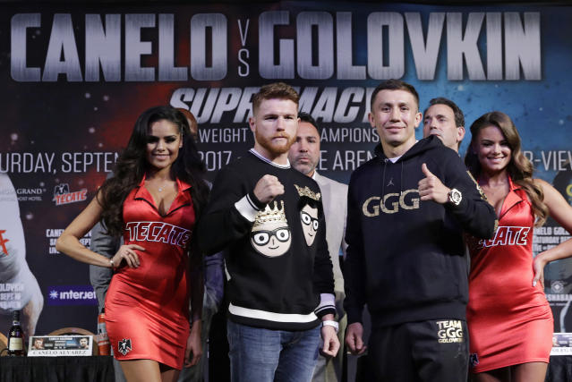 FILE - In this Sept. 13, 2017, file photo, Canelo Alvarez, left, and Gennady Golovkin pose for photographers during a news conference in Las Vegas. Golovkin and Alvarez had to follow a circus to town the first time they met a year ago. Maybe that's why they've created a bit of an act themselves for their fight Saturday night for the middleweight title. (AP Photo/John Locher, File)