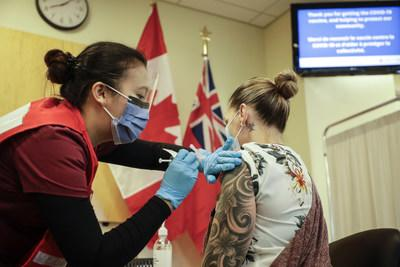 Venus Lucero, RPN, administers The Ottawa Hospital Vaccine Clinic's first vaccine to a patient in December 2020, Photo Credit: Jacob Ferguson, The Ottawa Hospital (CNW Group/The Canadian Nurses Foundation)