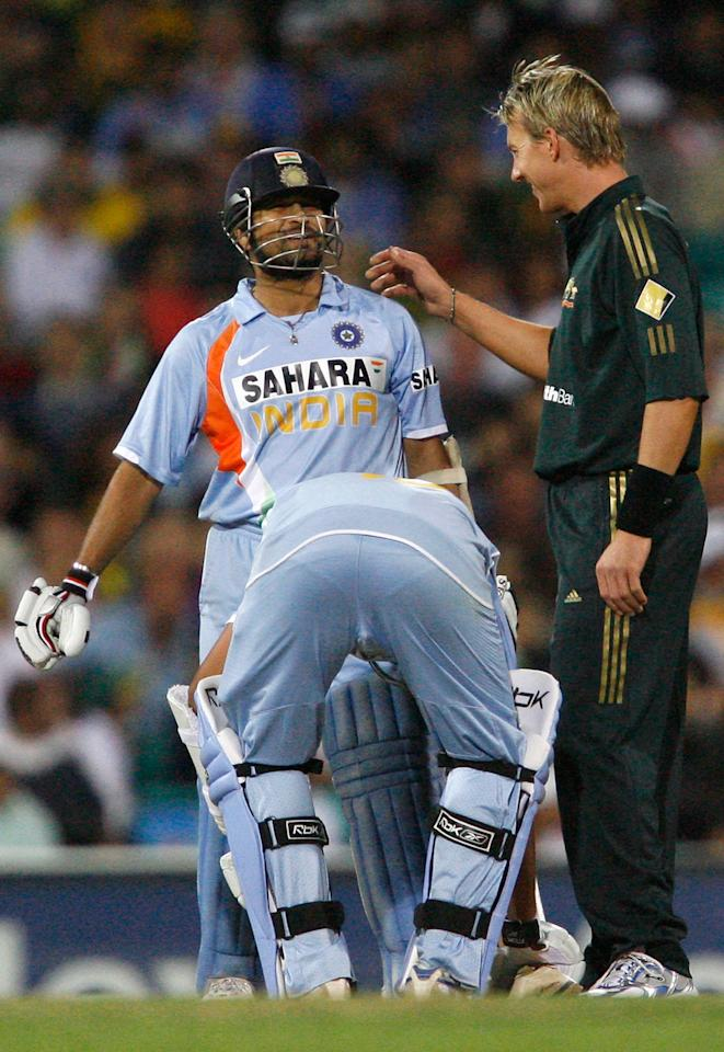 SYDNEY, AUSTRALIA - MARCH 02:  Brett Lee of Australia (R) checks on Sachin Tendulkar of India after bowling a high delivery which hit him during the Commonwealth Bank One Day International Series first final match between Australia and India at the Sydney Cricket Ground on March 2, 2008 in Sydney, Australia.  (Photo by Sergio Dionsio/Getty Images)