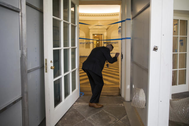 <p>A Secret Service agent checks on the Oval Office of the White House in Washington, Friday, Aug. 11, 2017, as the West Wing of the White House in Washington is undergoing renovations while President Donald Trump is spending time at his golf resort in New Jersey. (AP Photo/J. Scott Applewhite) </p>