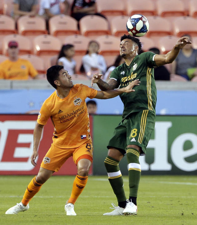 Houston Dynamo midfielder Memo Rodriguez (8) pushes off Portland Timbers defender Julio Cascante (18) as he gets the header during the first half of an MLS soccer match Wednesday, May 15, 2019, in Houston. (AP Photo/Michael Wyke)