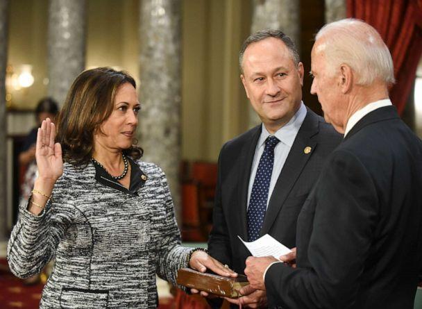 PHOTO: In this Jan. 3, 2017 file photo, Vice President Joe Biden administers the Senate oath of office to Sen. Kamala Harris, as her husband, Doug Emhoff, holds the Bible on Capitol Hill in Washington, D.C., as the 115th Congress begins. (Kevin Wolf/AP, FILE)