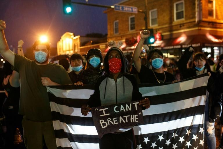 Protesters gather near the scene where George Floyd died in police custody in Minneapolis