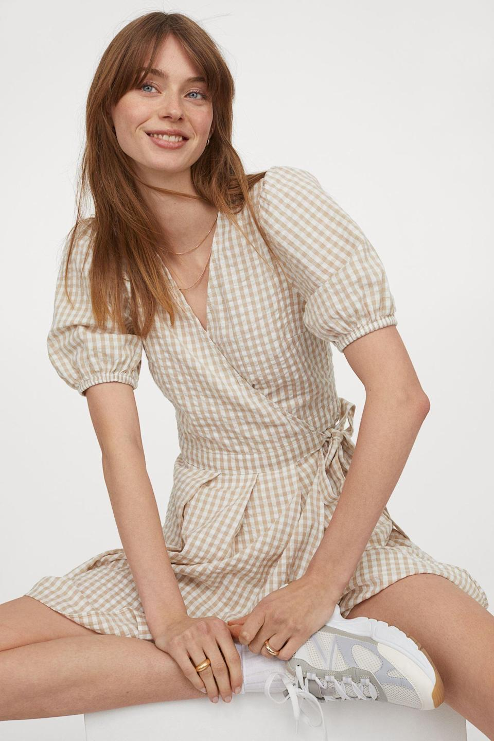 <p>The puff sleeves and relaxed bodice of this <span>Linen-blend Wrapover Dress</span> ($40) give it an easygoing, warm-weather look.</p>