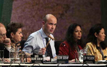 President of COP19 Marcin Korolec gavels through final decisions at COP19 in Warsaw