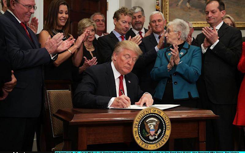Donald Trump signs an executive order on healthcare - Getty Images North America
