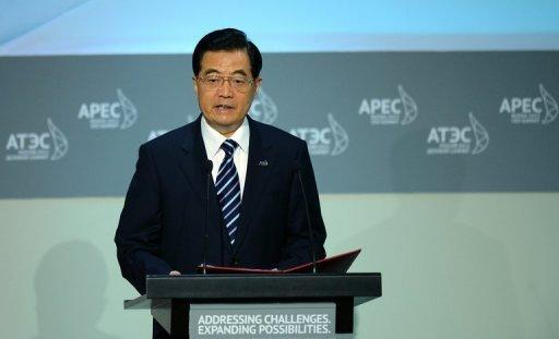 """Chinese President Hu Jintao delivers his address at the APEC summit in Vladivostok on September 8. """"We will work to maintain a balance among keeping steady and robust growth... and managing inflation expectations,"""" he said"""