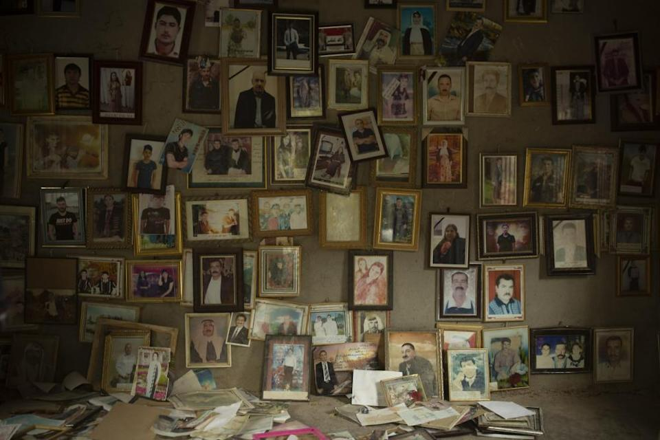 Photographs of Yazidis killed in 2014 by Isis militants at the Lalish temple, above the town of Shekhan, in northern Iraq, on 12 September 2019.