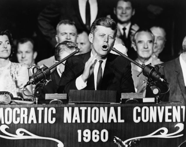 <p>Democratic presidential nominee Sen. John F. Kennedy thanks the Democratic National Convention for selecting him, on July 13, 1960, in Los Angeles. Kennedy won the nomination with a smashing first-ballot victory that pitted him against Vice President Richard M. Nixon. (Photo: Bettmann Archive/Getty Images) </p>