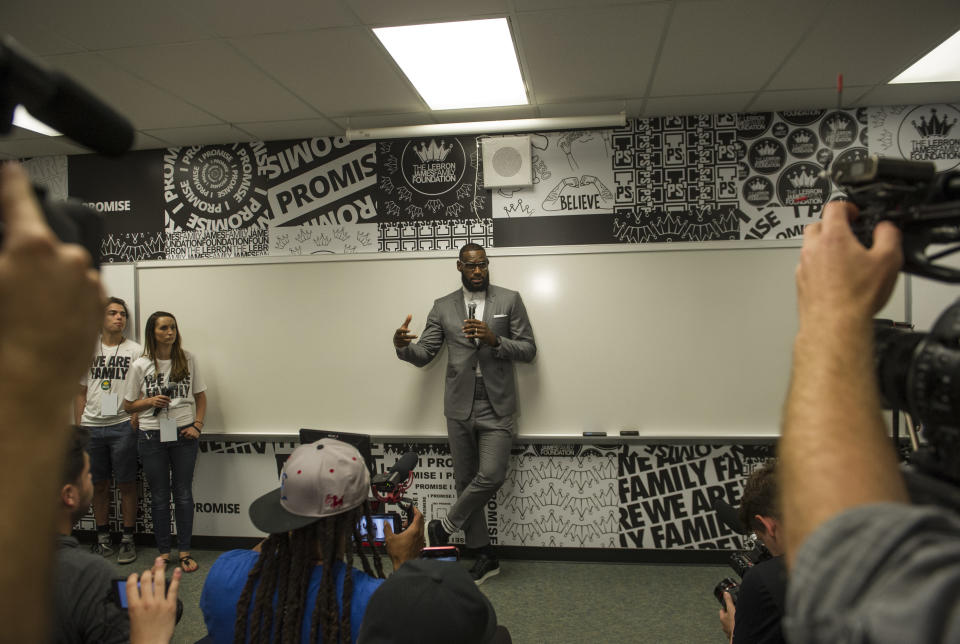 LeBron James speaks at a news conference after the opening ceremony for the I Promise School in Akron, Ohio, Monday, July 30, 2018. (AP Photo/Phil Long)