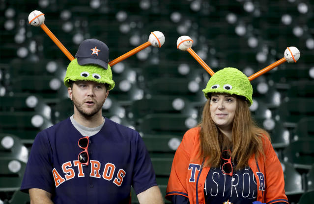 Houston Astros fans watch during batting practice before Game 4 of a baseball American League Championship Series against the Boston Red Sox on Wednesday, Oct. 17, 2018, in Houston. (AP Photo/Frank Franklin II)