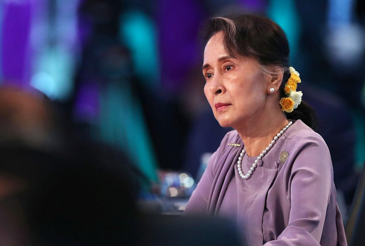 Myanmar's State Counsellor Aung San Suu Kyi listens to Australian Prime Minister Malcolm Turnbull speak at the start of the Leaders' Plenary session during the one-off summit of 10-member Association of Southeast Asian Nations (ASEAN) in Sydney, Australia, March 18, 2018.     Mark Metcalfe/Pool via REUTERS *** Local Caption *** Malcolm Turnbull