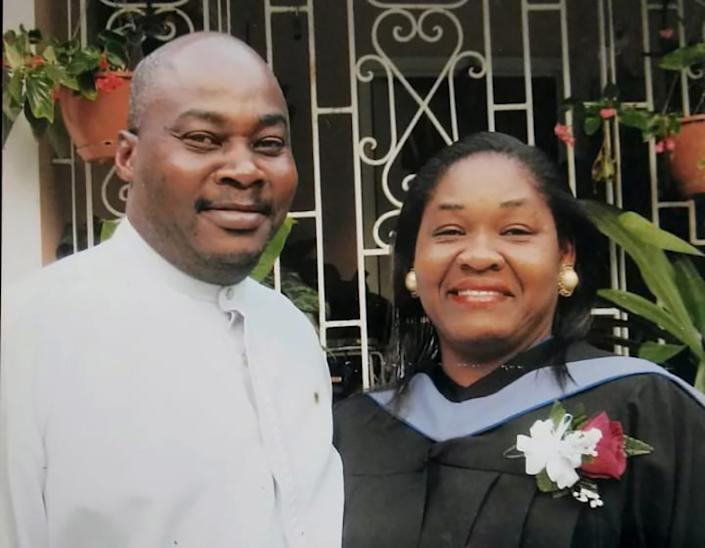 """Farmworker Earl Edwards, a Jamaican who died last week in Washington state while in quarantine for suspected COVID-19, celebrates a graduation with his wife, Marcia, in 2011. <span class=""""copyright"""">(Courtesy of Edwards family)</span>"""