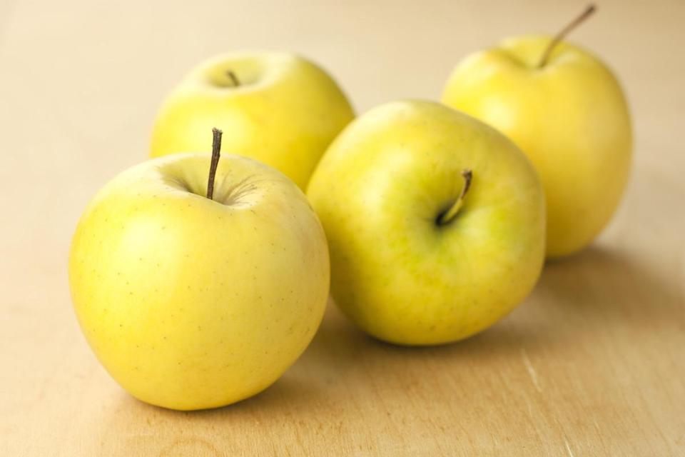 <p>Golden Delicious apples are actually not related in any way to Red Delicious apples; in fact, these apples are parents of Gala, Jonagold and Crispin apples. They're firm and crisp with a honeylike, mildly sweet flavor.</p>