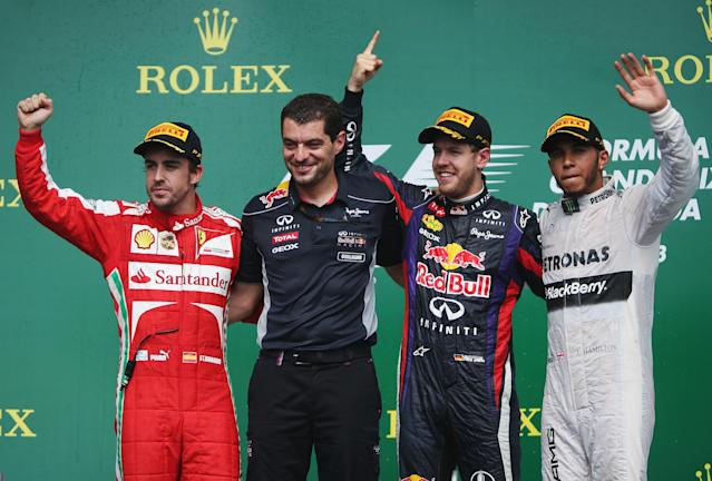 MONTREAL, QC - JUNE 09: Sebastian Vettel (2nd right) of Germany and Infiniti Red Bull Racing celebrates with his race engineer Guillaume Rocquelin (2nd left), second placed Fernando Alonso (left) of Spain and Ferrari and third placed Lewis Hamilton (right) of Great Britain and Mercedes GP following the Canadian Formula One Grand Prix at the Circuit Gilles Villeneuve on June 9, 2013 in Montreal, Canada. (Photo by Mark Thompson/Getty Images)