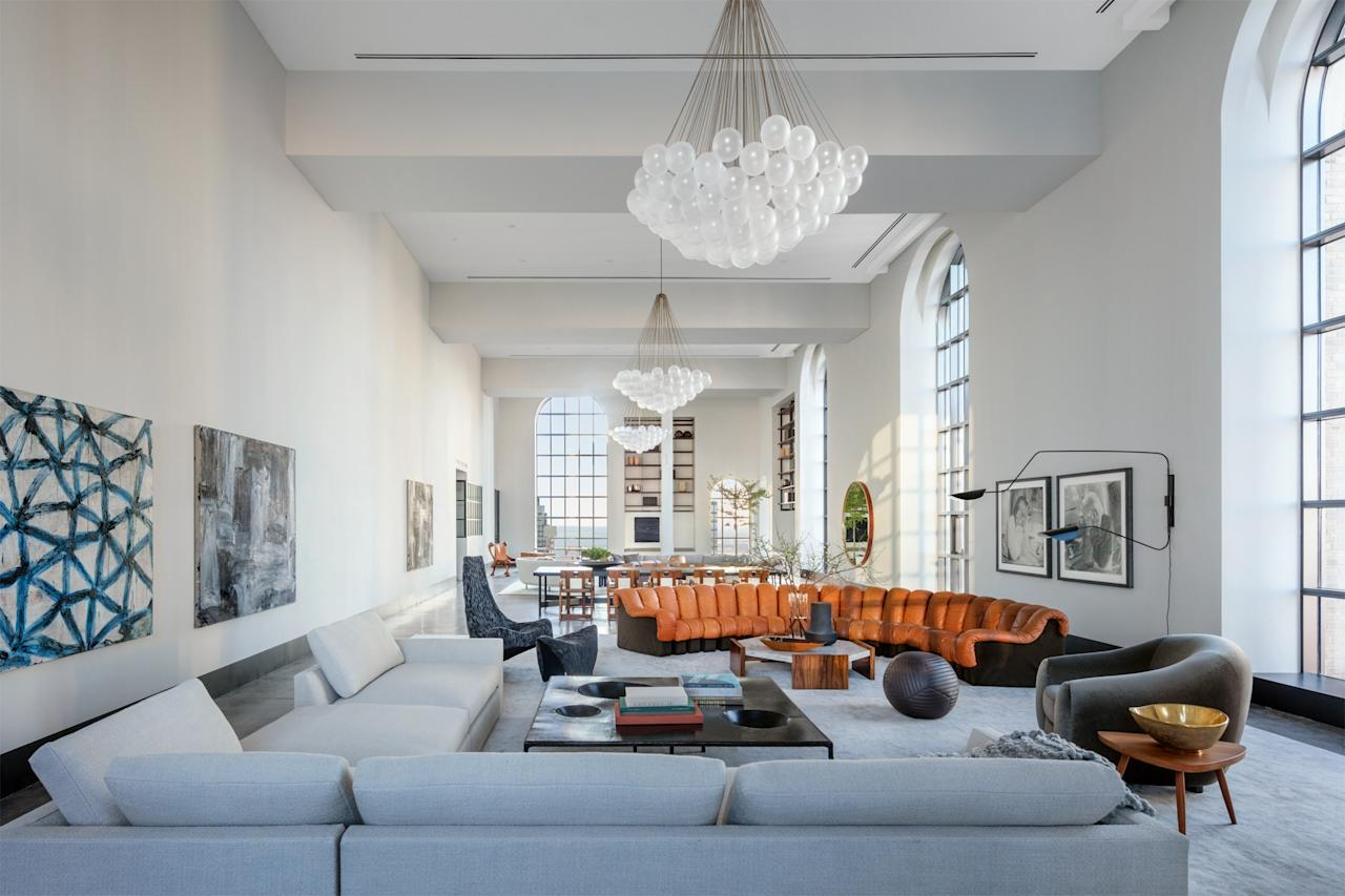 """The penthouse of One Hundred Barclay is quintessential 'downtown,' and the space itself is so grand in terms of size and in terms of history, it was a natural choice to use furnishings that have an edge but still have that feel of being perfectly timeless,"" explains the designer. Large-scale art also makes use of the immense amount of wall space."