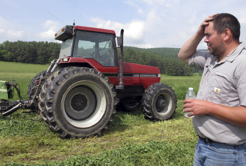 Dairy farmer Ransom Conant discusses the challenges of a wet spring as he prepares to cut an alfalfa and grass crop, in Richmond, Vt., on Tuesday, June 13, 2017, which is late for the season. Following dry and drought conditions last summer, Northeast farmers are facing the opposite challenge this growing season: a rainy, cool spring that has delayed the planting of corn and other crops and the first cutting of hay for livestock feed.. (AP Photo/Lisa Rathke)