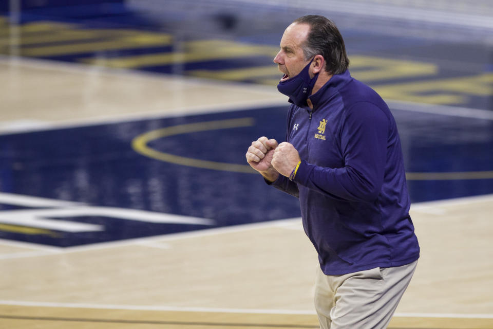 Notre Dame head coach Mike Brey cheers on his players during the second half of an NCAA college basketball game against Miami, Sunday, Feb. 14, 2021, in South Bend, Ind. (AP Photo/Robert Franklin)