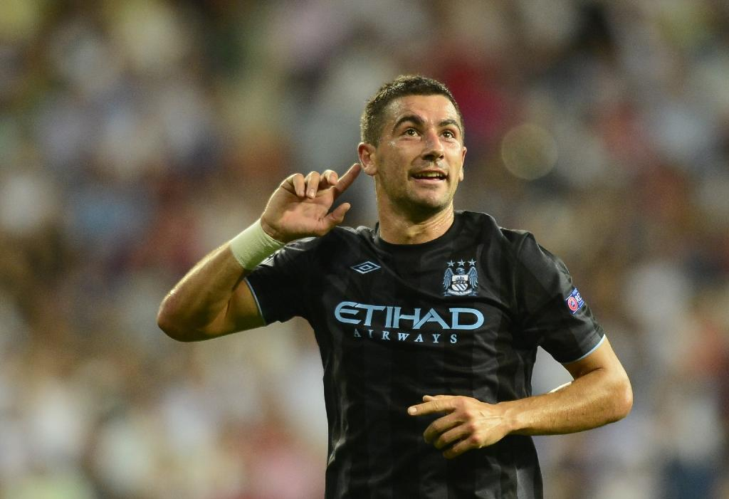 Manchester City's left-back Aleksandar Kolarov is on the verge of a move to Serie A side AS Roma, Blues boss Pep Guardiola said (AFP Photo/JAVIER SORIANO)