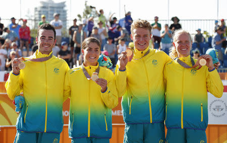 Triathlon - Gold Coast 2018 Commonwealth Games - Mixed Team Relay Final - Southport Broadwater Parklands - Gold Coast, Australia - April 7, 2018. Gold medallists Team Australia members Gillian Backhouse, Matthew Hauser, Ashleigh Gentle and Jacob Birtwhistle hold their medals. REUTERS/David Gray