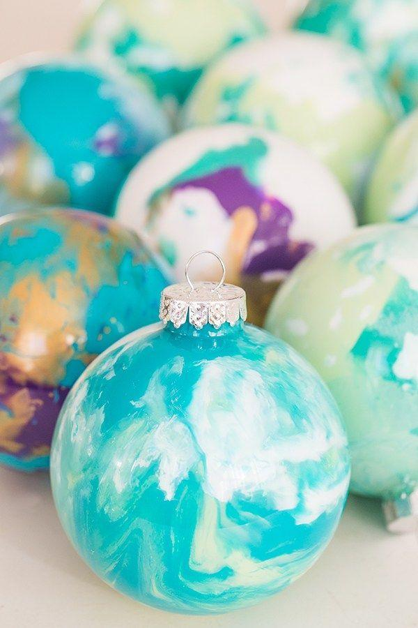 "<p>Christmas tree ornaments are so much more special when they have sentimental value. Make your own marbled ornaments with this guide from <a href=""https://sugarandcharm.com/diy-marbled-ornaments"" rel=""nofollow noopener"" target=""_blank"" data-ylk=""slk:Sugar and Charm"" class=""link rapid-noclick-resp"">Sugar and Charm</a> and spotlight your favorite colors. </p>"