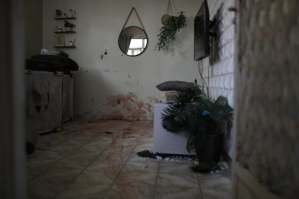 Blood covers the floor inside a home after a police operation targeting drug traffickers in the Jacarezinho favela of Rio de Janeiro, Brazil, Thursday, May 6, 2021. At least 25 people died including one police officer and 24 suspects, according to the press office of Rio's civil police. (AP Photo/Silvia Izquierdo)
