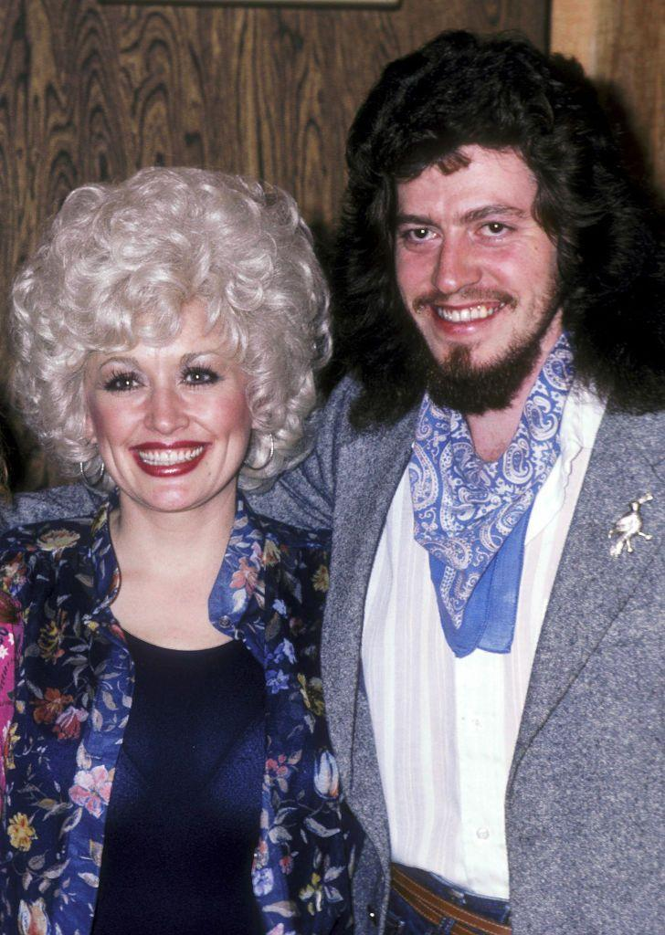 "<p>Dolly is pictured here with her brother Floyd, who penned her songs <em>""</em>Rockin' Years,"" ""Nickels and Dimes,"" and <em>""</em>Waltz Me to Heaven"" from <em>Rhinestone.</em></p>"