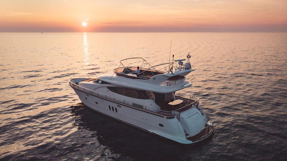 Cruising across the ocean, cruising on a luxurious yacht, yacht with strong engine, sunset, seaside, holiday on deck, sweet life on deck, driving yacht across the coastline.