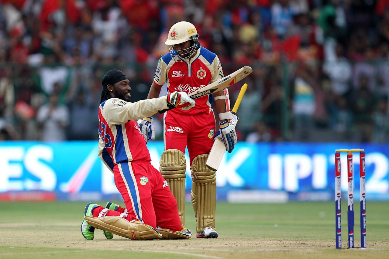 Chris Gayle acknowledges on hitting century during match 31 of the Pepsi Indian Premier League between The Royal Challengers Bangalore and The Pune Warriors India held at the M. Chinnaswamy Stadium, Bengaluru  on the 23rd April 2013Photo by Prashant Bhoot-IPL-SPORTZPICS  Use of this image is subject to the terms and conditions as outlined by the BCCI. These terms can be found by following this link:https://ec.yimg.com/ec?url=http%3a%2f%2fwww.sportzpics.co.za%2fimage%2fI0000SoRagM2cIEc&t=1506444649&sig=F1mLp5c3piGf1wumOsxyuw--~D
