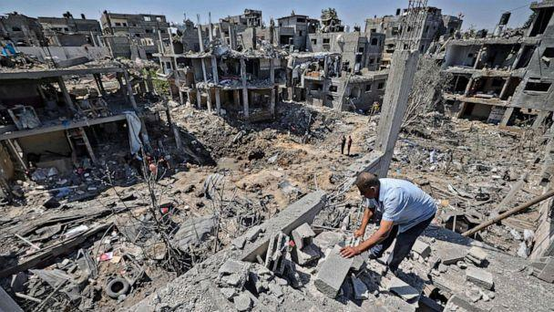 PHOTO: Palestinians assess the damage caused by Israeli air strikes, in Beit Hanun in the northern Gaza Strip, May 14, 2021. (Mahmud Hams/AFP via Getty Images)