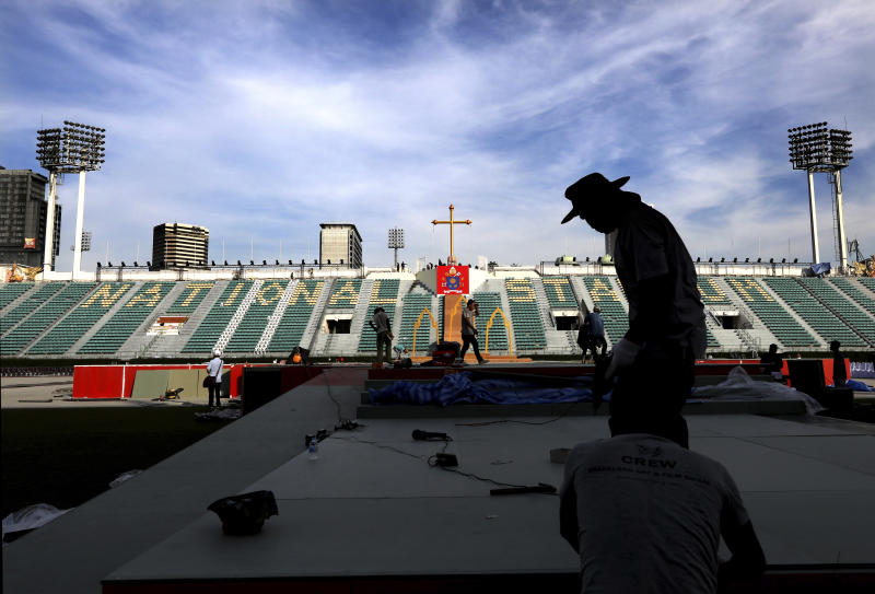 Workers prepare the stage at the National stadium from where Pope Francis is scheduled to  conduct holy mass on Thursday, in Bangkok, Thailand, Tuesday, Nov. 19, 2019. Pope Francis arrives in Thailand on Wednesday for the first visit here by the head of the Roman Catholic Church since St. John Paul II in 1984. (AP Photo/Manish Swarup)