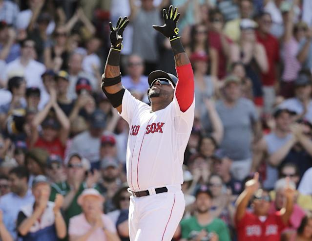 Boston Red Sox designated hitter David Ortiz raises his arms as he crosses home plate after his game-tying, solo home run during the 10th inning of a baseball game at Fenway Park in Boston, Wednesday, June 18, 2014. The Red Sox won 2-1 in 10 innings. (AP Photo/Charles Krupa)