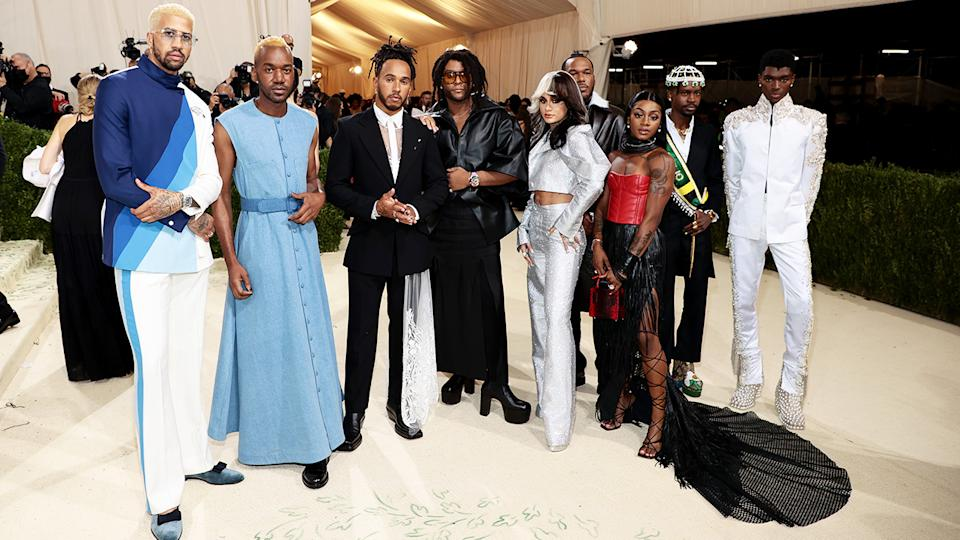 Lewis Hamilton, pictured here with a number of upcoming fashion designers at the Met Gala.