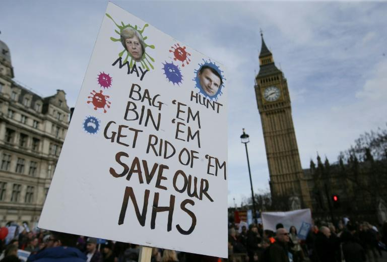 Demonstrators rally in support of keeping the NHS public in front of Big Ben at the Houses of Parliament March 4, 2017