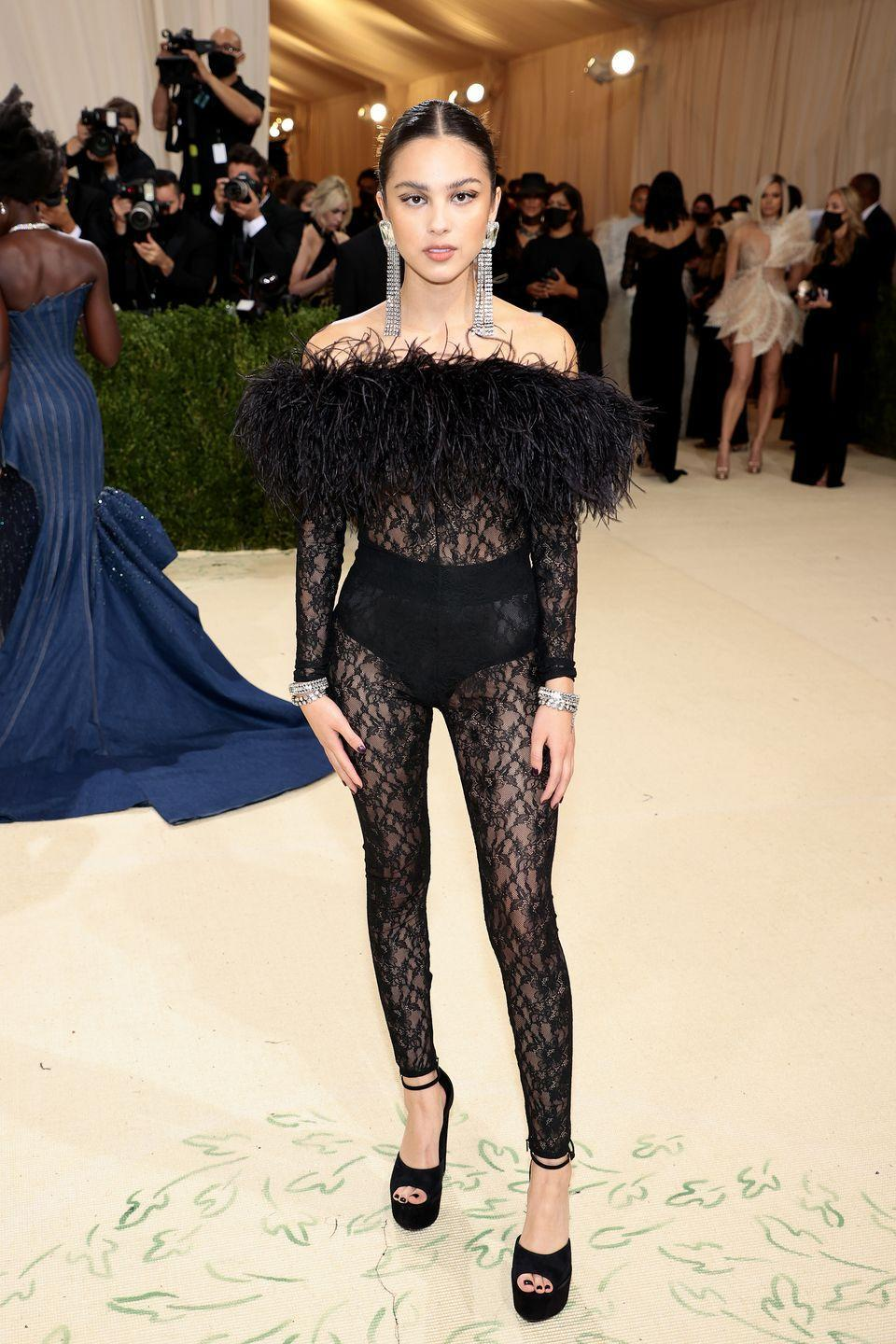 """<p>The """"Brutal"""" singer stepped out in a black lace catsuit that seemed a little more appropriate for the VMAs, but still managed to deliver that high-fashion feeling the Met Gala asks for. Besides, if there was one major trend of the night, it was definitely see-through and tight-fitting. She told interviewers that her lacy look was a nod to American punk music. </p>"""