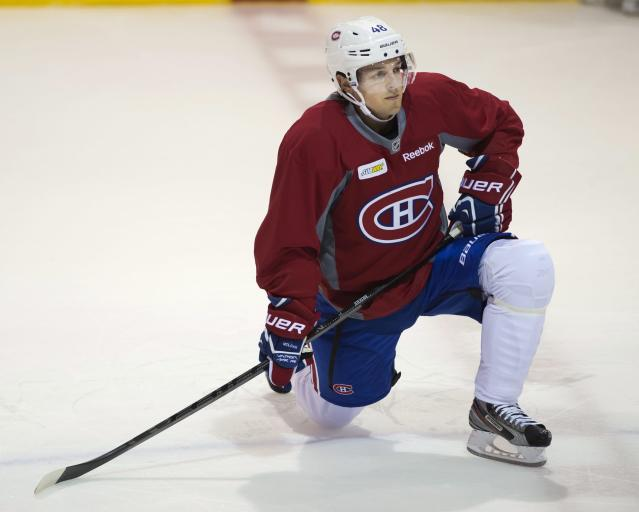 Montreal Canadiens forward Danny Briere stretches during the team's NHL hockey training camp, Thursday, Sept. 12, 2013 in Brossard, Quebec. (AP Photo/The Canadian Press, Ryan Remiorz)