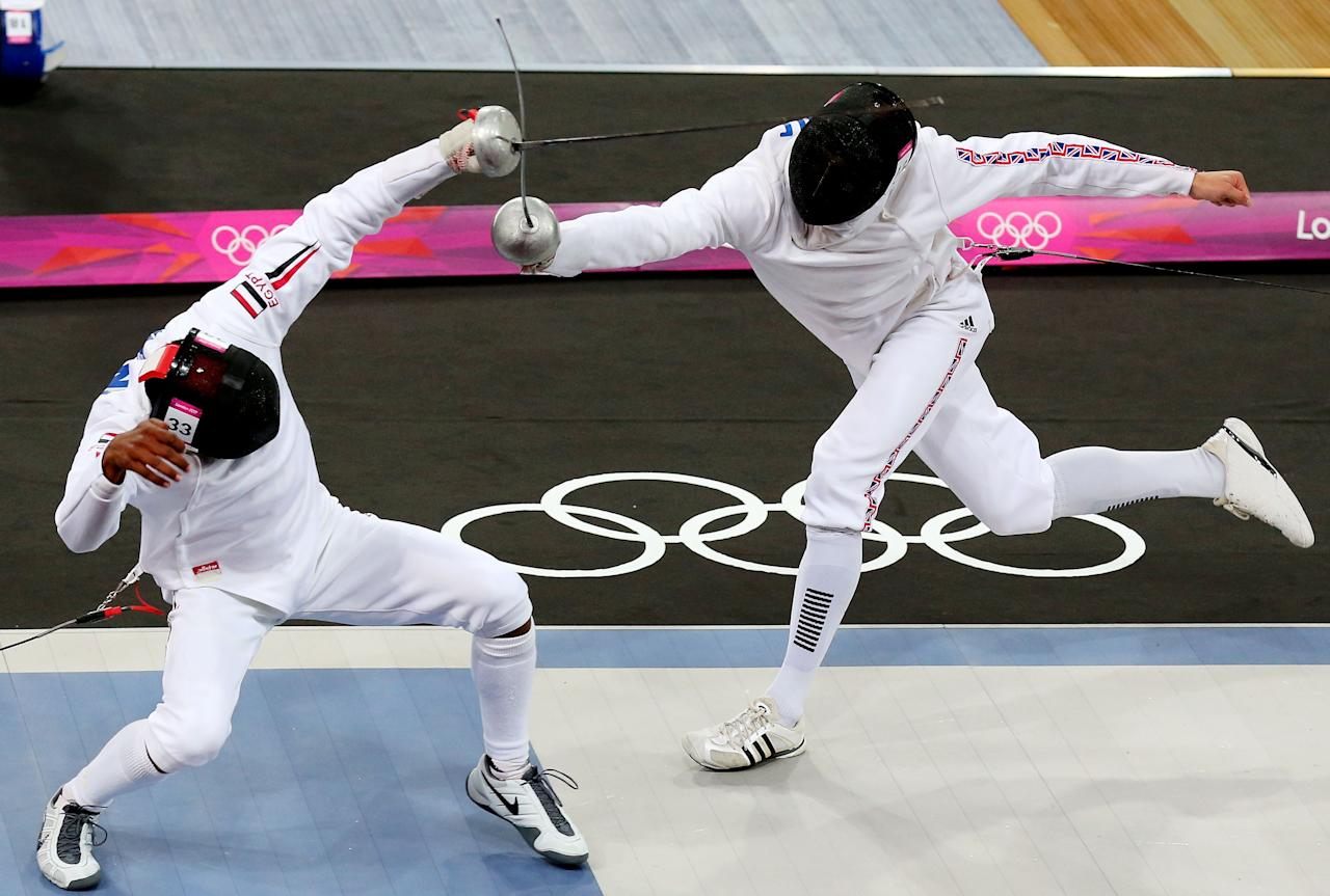 LONDON, ENGLAND - AUGUST 11:  Samuel Weale (R) of Great Britain competes against Yasser Hefny (L)of Egypt in the Fencing event during the Men's Modern Pentathlon on Day 15 of the London 2012 Olympic Games on August 11, 2012 in London, England.  (Photo by Alex Livesey/Getty Images)