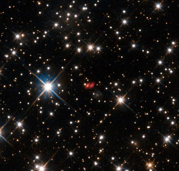 This image from the NASA/ESA Hubble Space Telescope shows the distant active galaxy PKG 1830-211. It shows up as an unremarkable looking star-like object, hard to spot among the many much closer real stars in this picture. Recent ALMA observati