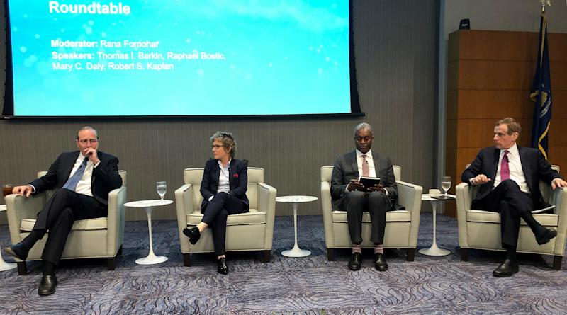 Richmond Fed President Thomas Barkin (L), San Francisco Fed President Mary Daly, Atlanta Fed President Raphael Bostic (2nd R) and Dallas Fed President Robert Kaplan (R) sit together at the final session of a Dallas Fed conference on technology in Dallas, Texas, U.S., May 23, 2019. REUTERS/Ann Saphir