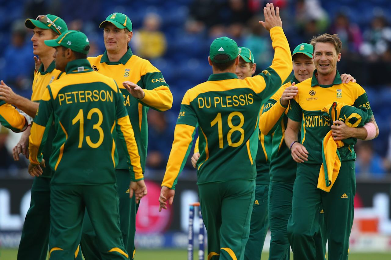 CARDIFF, WALES - JUNE 14: Dale Steyn (R) of South Africa accepts the congratulations from team mates after capturing the wicket of Johnson Charles of West Indies during the ICC Champions Trophy Group B match between West Indies and South Africa at the SWALEC Stadium on June 14, 2013 in Cardiff, Wales.  (Photo by Michael Steele/Getty Images)