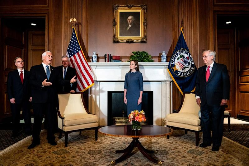Seventh U.S. Circuit Court Judge Amy Coney Barrett, President Donald Trump's nominee for the U.S. Supreme Court, attends a meeting with Vice President Mike Pence (L) and Senate Majority Leader Mitch McConnell (R-KY) (R) at the U.S. Capitol in preparation for her confirmation hearing, on September 29, 2020 in Washington, DC.