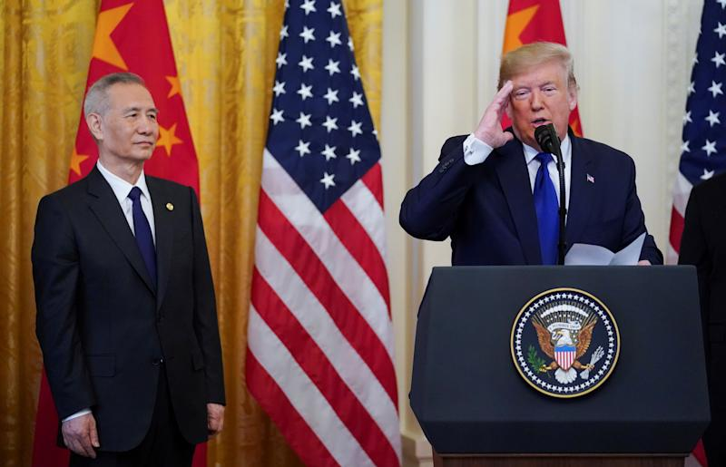 "Chinese Vice Premier Liu He listens as U.S. President Donald Trump speaks during a signing ceremony for ""phase one"" of the U.S.-China trade agreement in the East Room of the White House in Washington, U.S., January 15, 2020. REUTERS/Kevin Lamarque"
