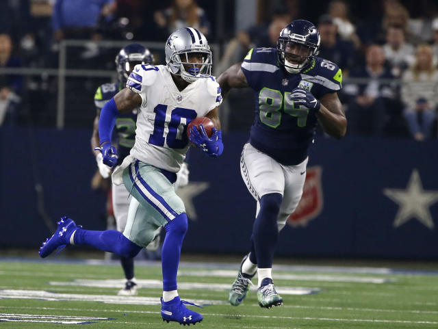 FILE - In this Jan. 5, 2019, file photo, Dallas Cowboys' Tavon Austin (10) returns a punt for a long gain as Seattle Seahawks' Ed Dickson gives chase during an NFC wild-card NFL football game in Arlington, Texas. Austins fresh start with the Cowboys wasnt much different than the stale final season the versatile receiver endured with the Los Angeles Rams. The difference is that Austin has a chance to change the feeling, against his former team no less, in the divisional round of the playoffs. The Cowboys traded for Austin during the draft, but he missed nine games after injuring a groin. (AP Photo/Ron Jenkins, File)
