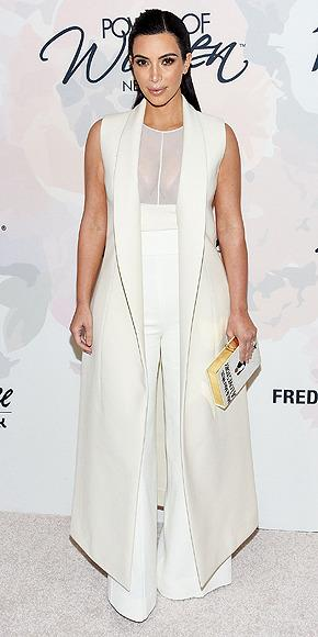 """<p><b>VARIETY'S POWER OF WOMEN LUNCHEON 2015</b><br>  The star must have a closet dedicated to her nude bras, flashing her undergarments once again in a sheer top, plus, high-waisted flare trousers and an ankle-grazing vest (both Narciso Rodriguez). But the buzziest part of this look was her custom Olympia Le-Tan book clutch reading, """"Mr. and Mrs. West, A Love Story.""""</p>"""
