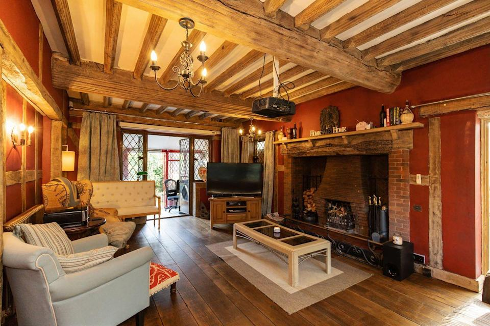 "<p>As snug as can be, this <a href=""https://www.housebeautiful.com/uk/decorate/living-room/g32357518/living-room-accessories/"" rel=""nofollow noopener"" target=""_blank"" data-ylk=""slk:living room"" class=""link rapid-noclick-resp"">living room</a> has an open fireplace, wooden beams, cushiony soft sofas and glorious views across the garden. </p>"